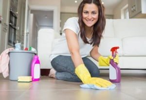 Woman kneeling at the floor cleaning